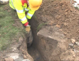 The roadside excavation for a broadband cabinet with Conducrete poured into duct trench