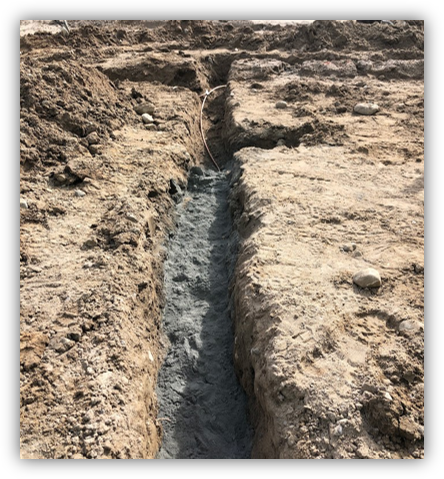 A lateral excavation with Conducrete installed over bare cable